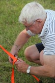 Alan Butcher putting up the Pymoor Social Club tent in Graham Lark's field, off Pymoor Lane, in readiness for the Pymoor Show 2011