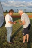 Inger Van Ogtrop & Alan Butcher putting up the Pymoor Social Club tent in Graham Lark's field, off Pymoor Lane, in readiness for the Pymoor Show 2011