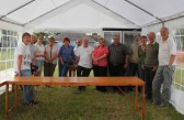 Some of the Pymoor Social Club members pose for a photograph after putting up the tent in readiness for the Pymoor Show 2011