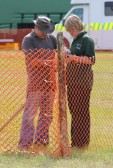 Gary Palmer and Jordan Feast putting up fencing for the Pymoor Show 2011