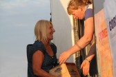Pat Golding handing Cider to Emma Ure in the the Chiller Van ready for the Pymoor Show 2011