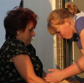 Christine Saberton handing Cider to Emma Ure in the the Chiller Van ready for the Pymoor Show 2011