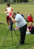Basil Taylor, with a video camera, at the Royal Wedding Fun Day in Pymoor, 2011.