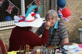 Jeanette Moser, painting her husband, Alan's face at the Royal Wedding Fun Day in Pymoor 2011.