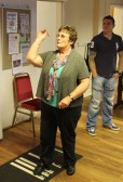 Cynthia Parson in the Darts competition in the Pymoor Cricket & Social Club Christmas Bazaar 2011.