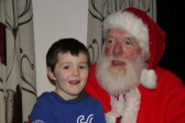 Harrison Golding lets Santa know that he's been a good boy all year at the Pymoor Cricket & Social Club Christmas Bazaar 2011.