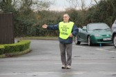 A Race Marshall stands at the crossroads in Pymoor directing competitors in the Ely New Year's Eve Charity Fun Run 2011.