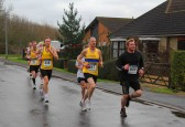 Competitors make their way along Pymoor Lane, Pymoor, in the Ely New Year's Eve Charity Fun Run 2011.