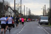Competitors make their way along Main Street, Pymoor, in the Ely New Year's Eve Charity Fun Run 2011.