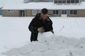 Shaun Butcher of Pymoor adds another iceblock to the Igloo. Pymoor received a significant fall of snow during the night of the 4th/5th February 2012.