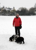 Pymoor received a significant fall of snow during the night of the 4th/5th February 2012. Maggie Taylor takes her dog Alfie for a walk in the snow.