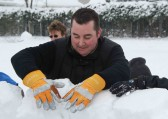 Mark Taylor adds an iceblock to the Igloo he is building. Pymoor received a significant fall of snow during the night of the 4th/5th February 2012.
