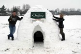Daniel & Zac Coulson apply the finishing touches to the Igloo built by the villagers of Pymoor.