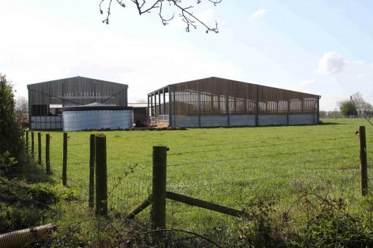 Farm buildings seen from Pygore, Pymoor, 2012.