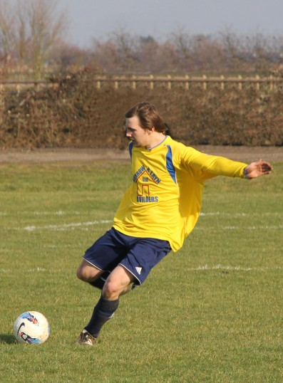 Ed Hale playing for Little Downham FC at the club's home ground in Pymoor, 2012.