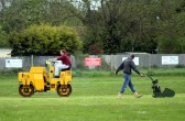 Preparing the Pymoor Cricket Club pitch for the coming season.