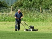 Michael Saberton tidies up the boundary in readiness for Pymoor CC's next home match.
