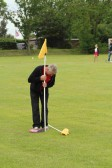 Michael Saberton marks the length of the Wellington Boot throw during the Diamond Jubilee Fun Day in Pymoor 2012.