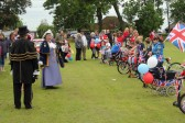 Judging the best decorated bike competition at the Diamond Jubilee Fun Day in Pymoor 2012.