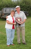 Cynthia Parson presents the winner's shield to Ray Ayres at the Roger Parson Memorial Charity Fishing Match at Oxlode Lakes, Oxlode, Pymoor 2012.