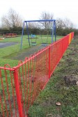 A new metal fence has been erected around the chidren's play area at the Pymoor Cricket & Social Club, Pymoor Lane, Pymoor, 2012.