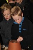 Finley Taylor watches his brother James at the Pymoor Cricket & Social Club Christmas Bazaar 2012