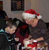 Maggie Taylor with Joshua Stacey at the Pymoor Cricket and Social Club Christmas Bazaar 2012