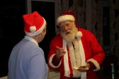 Rosemary Davis chats to Santa at the Pymoor Cricket & Social Club Christmas Bazaar 2012