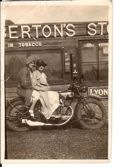 Sisters Eva and Naomi Martin outside Saberton Stores in Main Street Pymoor (circa 1930).