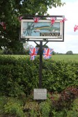 Some villagers in Pymoor decorated the village sign with flags & bunting to celebrate the Diamond Jubilee of Queen Elizabeth II 2012.