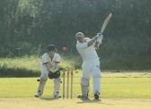 Steve Saberton playing for Pymoor CC in their evening Kirkland Cup match against Ely CC.