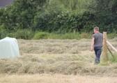 Jaime Butcher checks the progress of the hay baling on Graham Lark's field off Pymoor Lane, Pymoor.