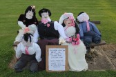 A Scarecrow Wedding Party sitting on the bench outside the Methodist Chapel in Main Street, Pymoor 2012.
