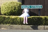 A scarecrow sits at the corner of Main Street, Pymoor 2012.