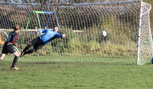 Goal! Pymoor FC find the net in their charity football match against their fathers 2012.
