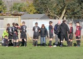 It is half time & Pymoor FC receive a team talk during their charity football match in Pymoor 2012.