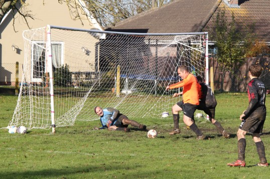 A goal mouth scramble during the charity football match in Pymoor 2012.