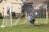 The goalkeeper pulls off a good save during the charity football match in Pymoor 2012.