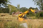 Darren Butcher loading straw bales in a field off Pymoor Lane, Pymoor. 2013