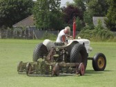 Michael Saberton cutting the Pymoor Cricket Club Field