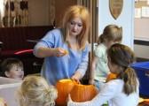 Pumpkin carving for Halloween at the Kid's Holiday Club 2013.