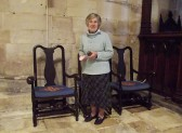 Elizabeth Patterson, formally of Little Downham & Pymoor, polishing the chairs in Tewkesbury Abbey.