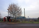 Bus Shelter & Village Sign at the crossroads in Pymoor 2013