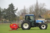 Aerating the Pymoor Cricket Club field 2013.