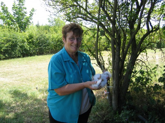 Cynthia Parson with a Baby Barn Owl near Oxlode Fishing Lakes 2004