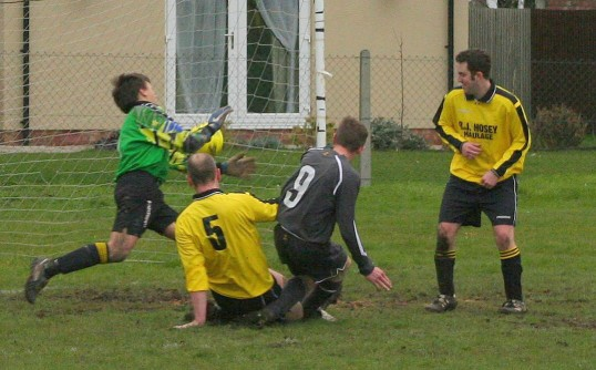Jason Cridford (No 9) scores the 2nd of his three goals in Pymoor F.C.'s 5 - 0 win over Needingworth United at the Pymoor Sports Ground 2008.