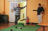 Bill Dennis and Inger van Ogtrop examine the state of play during a game of carpet bowls in the Pymoor Social Club, Pymoor, 2006.