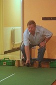 Neville Crick playing carpet bowls in the Pymoor Social Club, Pymoor 2006.