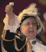 Ely Town Crier, Avril Hayter-Smith, announces the Raffle winner at the Diamond Jubilee Fun Day in Pymoor 2012.