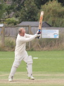 Chris Baker playing cricket for Pymoor CC, 2014